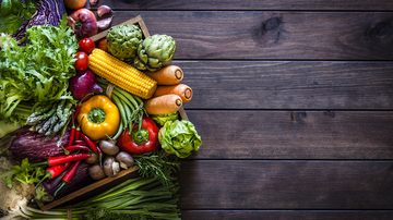 fruit and vegetables on a wooden background