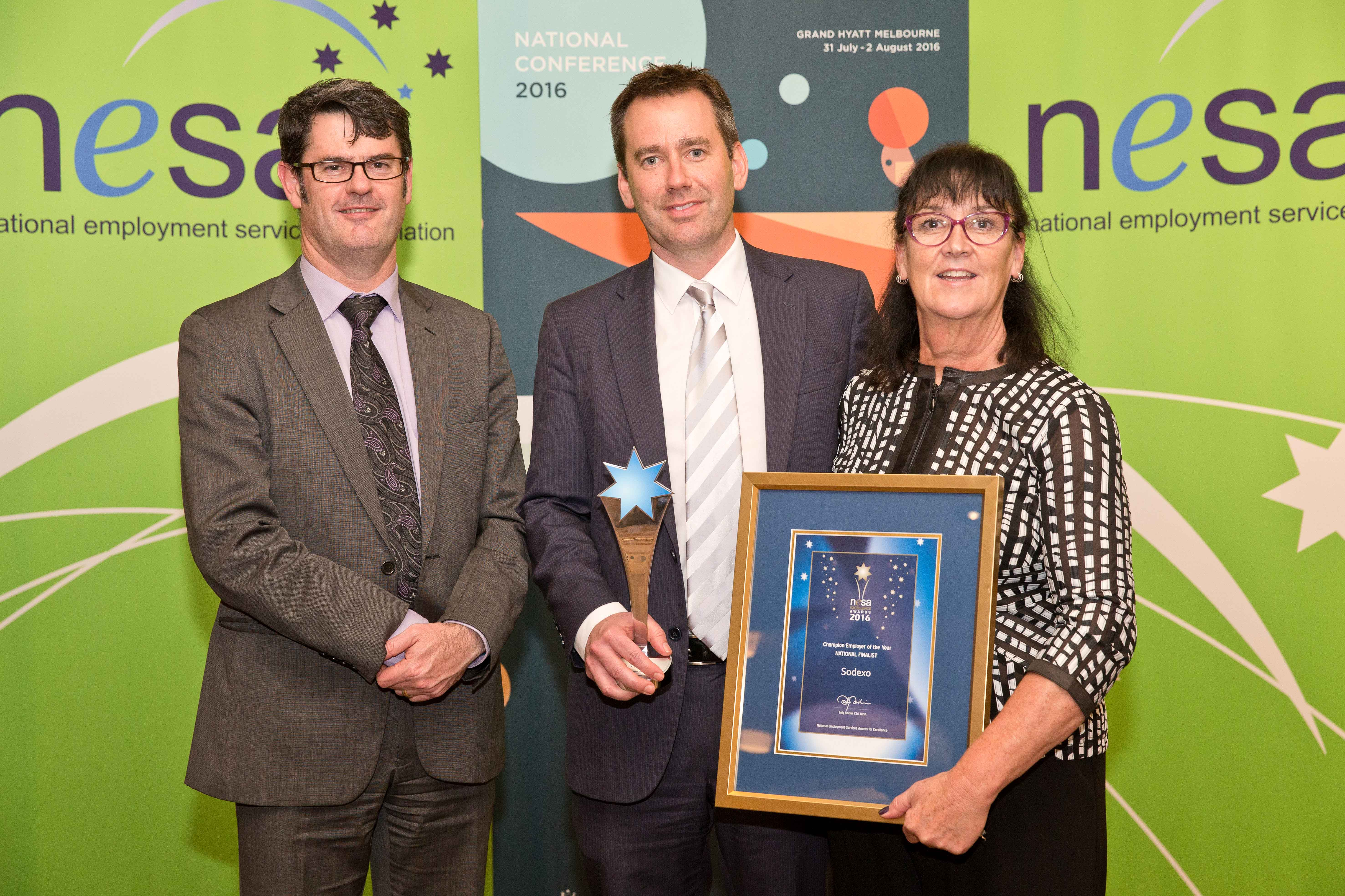 Nick O'Callaghan (Country President, Sodexo Australia), Wendy Dawson (GM Indigenous & Community Engagement) with Martin Hehir, Deputy Secretary of the Department of Employment, who presented the award.
